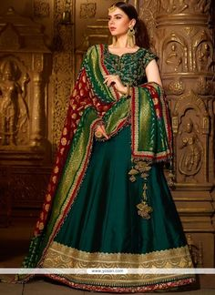 Bollywood diva drashti dhami style turquise embroidered lehenga style suit online which is crafted from satin georgette fabric with exclusive embroidery, zari and stone work. This stunning designer lehenga style suit comes with net bottom and net dupatta. Blue Lehenga, Lehenga Style, Silk Lehenga, Anarkali, Silk Kurti, Georgette Fabric, Silk Fabric, Sari, Indian Gowns