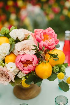 bohemian inspired wedding reception. lemons peony rose blush green pink flower centerpiece. garden wedding