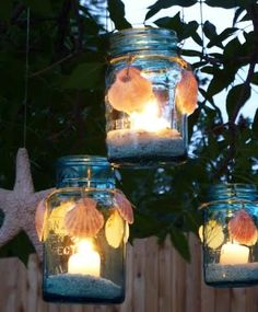 Hanging Mason Jar Lanterns: Scallop shells were tied on the outside (Drill Holes), and the candles sit on Crushed Shells