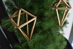 Learn how to make your own DIY geometric Christmas ornaments using little more than pipe, string and spray paint!