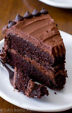 Triple Chocolate Layer Cake. The fudgiest homemade chocolate cake ever! sallysbakingaddiction.com