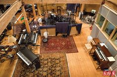 James Taylor's backing band was tracked live at the Barn, with the singer/ guitarist in a  booth. This photo shows the layout of the large space where the musicians played together. #cSw:) - PROFESSIONAL RECORDING MUSIC PRODUCTION - https://www.pinterest.com/claxtonw/professional-recording-music-production/ - Very Home like, comfortable music setting with many instruments at hand. Five–time Grammy winning Taylor invited the band to his  wooden barn home, 2013, to record.