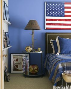 To coordinate with the flag in this Santa Fe, New Mexico, bedroom — a gift the homeowner received after making a speech in Washington — designer Emily Henry painted one wall in Enchanting Sky by Dunn-Edwards.