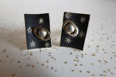 Check out this item in my Etsy shop https://www.etsy.com/listing/476344711/pair-of-vintage-space-age-cuff-links