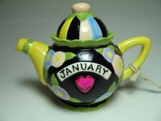 This is a 2005 Mary Engelbreit January Yellow And Black Mini Tea Pot with Tags and Box. Teapot is 4 inches tall and 5 inches across. It has a Garnet like January birthstone set in the center. Mary Engelbreit, Teapots And Cups, Teacups, Made By Mary, Tea Cafe, Teapots Unique, Holiday Images, Drinking Tea, Yellow Black