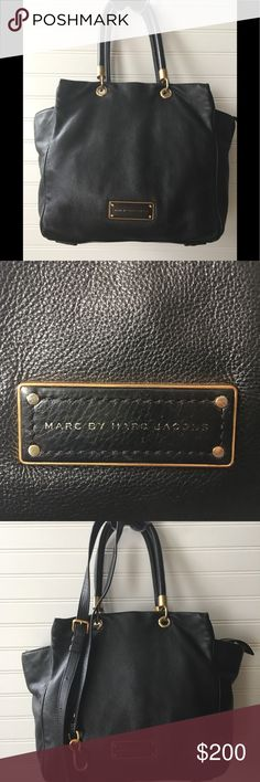 """Marc by Marc Jacobs Black Leather Cross Body Bag Marc by Marc Jacobs Black Leather Cross Body Bag Shoulder Bag CONDITION: Normal wear = Good Used Condition   100% Authentic  100% Cow Leather  Pebble leather texture  * Width expanded 16"""" Length from handle to bottom 20"""" * Length of purse only 12""""No scratches leather in excellent condition  Strap included in new condition never used strap Brass areas a little worn around handle. All measurements are approximations Marc by Marc Jacob Bags…"""