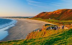 Rhossili bay in South Wales was a favourite retreat of Dylan Thomas and is a fine example of the pristine allure of the Welsh coastline