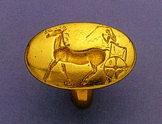 The Aidonia Treasure  - Gold signet ring engraved with a chariot scene.  ca. 1500 BC.  Diam. of bezel 2.1-3.3 cm., diam. of hoop (int.) 1.2 cm., weight 24.3 gr.