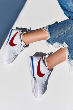 Nike Classic Cortez Premium Sneaker. Vintage-inspired design with timelessly cool appeal in this classic sneaker from Nike. Low-profile lace-up design in a sleek genuine leather with branded logo overlays. Finished with a wedge-cut EVA foam midsole + rubber herringbone sole for comfort, durability + traction. affiliate