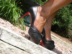 Knotted peep-toe Christian Louboutins. They're Nappa leather and feel like butter :-).