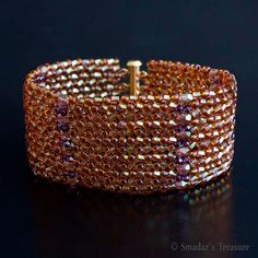 This sparkling topaz beaded bracelet is beadwoven with Japanese seed beads in dark topaz and with Czech short twisted bugle beads in light amethyst with gold luster finish. I added rows of 2.5mm Swarovski crystal beads in dark amethyst and Czech 4mm firepolished glass beads in gold