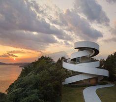 Designed by Hiroshi Nakamura & NAP Co., Ribbon Chapel is located at a…