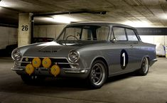 Silver Lotus Cortina sitting on Minilites