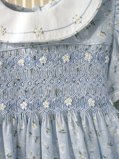 elaborate smocking and embroidery on a little girl's light grey blue dress Smocking Plates, Smocking Patterns, Sewing Patterns, Smocked Baby Clothes, Smocked Dresses, Smocked Clothing, Punto Smok, Heirloom Sewing, Fabric Manipulation