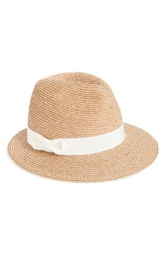Free shipping and returns on Helen Kaminski 'Mere' Raffia Fedora Hat at Nordstrom.com. An Italian grosgrain ribbon perfects a braided raffia fedora styled with an asymmetrical brim. Sateen elastic shapes an adjustable inner band for a perfect fit.