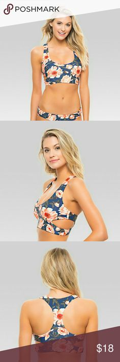 """Tori Praver Bikini Top Pullover racer back bralette bikini top with cutouts, Flattering shirring detail at center front, Product does not have padded inserts, but is double lined for a seamless look, Model is 5'9"""" with a 34B bust and is wearing a size Small. The Tonga Top in Indigo Sea Stripe by Tori Praver Seafoam Collection is the sophisticated look you need for your next getaway! This gorgeous pullover bikini top is fitness inspired with a low cut neck and eye catching cut outs…"""