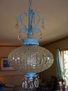 This vintage swag lamp was gold-toned and kind of obnoxious. I loved it anyway, but decided to spruce it up a bit with a can of Krylon Ocean Breeze Blue glossy spray paint. Now? I love it even more.
