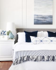 Calming light blue and white bedroom with a coastal vibe #bedroom #homedecor #coastaldecor #bedroomdecor