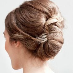 French twist updo- leave a few loose strands and stick some loose babys breath in there.