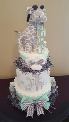 Baby Giraffe diaper cake! Adorable baby shower centerpiece gift.  Mint and grey name blocks, LUV. Check out my Facebook page Simply Showers for more pics and orders.