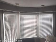 Bay windows can be expensive and difficult to decorate. Learn how to easily make this simple, gorgeous bay window curtain rod without spending a fortune. Diy Bay Window Curtains, Bay Window Curtain Poles, Bay Window Shutters, Bay Window Decor, Bay Window Living Room, Dining Room Windows, Rustic Curtains, Kitchen Window Decor, Bay Window Treatments