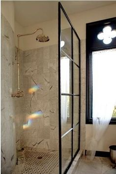 Salvaged steel window as shower partition