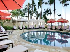 Condé Nast Traveler Gold List 2015: The Top Hotels in the World | Staying at Honolulu's The Royal Hawaiian (Luxury Collection) is like being transported back to the '50s or the '60s, when Waikiki had a very distinct place in America's collective imagination (Mad Men even filmed an episode here last year). The rooms in the original wing, with oversized carved koawood doors and tropical prints, are nostalgic of a decidedly glamorous period of American hospitality.