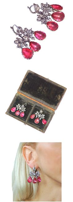 Silver and paste earrings, circa 1760, in the girandole form of a single round collet set with colourless paste suspending a ribbon-bow of colourless paste and three pear shaped cerise-pink paste drops. The girandole design of triple pendant drops originated at the court of Louis XIV in the late 17th century and remained fashionable throughout the 18th century. They are 1.5 inches in length and one inch wide.