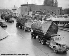 1940s log trucks in Washington State - one of David's favorite pictures. Get it printed and framed for him!!