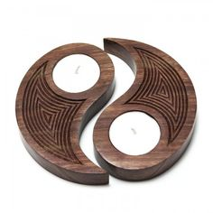 Wood Tealight Set: Carved wooden tea lights in a variety of shapes bring warmth and unique designs that make great housewarming or wedding gifts.