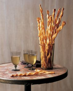These easy cheese-straw appetizers are made with frozen puff pastry and grated Parmesan cheese. In addition to cheese, you can vary the flavorings with poppy seeds, sesame seeds, paprika, or cayenne pepper. The baked and cooled straws will keep at room temperature up to one week.