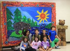Art Rocks!: Random Summer Mumble: Art Teacher Individuality. This is the massive recycling art project that the sun is just a small part of. It would probably take our church forever to save this many plastic lids.