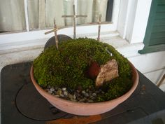 My mossy resurrection garden.  Next time, I'll paint the inside of the pot to look like stone.