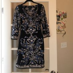 Dress Excellent condition.  Multi colored dress. Hits above knee. Various shades of blue  black background White House Black Market Dresses Midi
