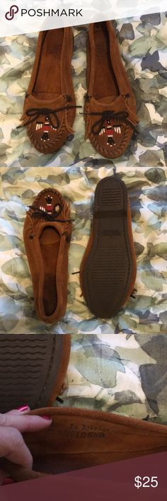 Minnetonka Thunderbird beaded fringe moccasins Brown suede moccassins with fringe and beaded thunderbird. A classic! Soles, heels, and insides in good condition. Minnetonka Shoes Moccasins