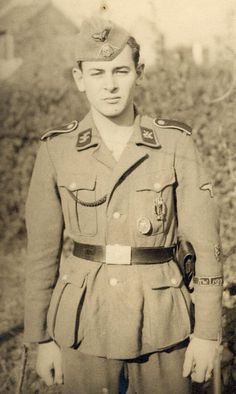 A SS-Legion Flandern volunteer showing the (apparently rare since not many photos show it) Flemish Lion collar badge as well as the standard Cuff Title & arm shield on his left arm.