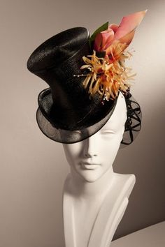 Stephen Jones Millinery - this is particularly appealing to me. one issue i have with a great deal of the ready-to-wear hats is the unrelenting monochromatic nature of the materials. this is a departure without being ostentatiously couture, and thus removing it from the ready-to-wear category