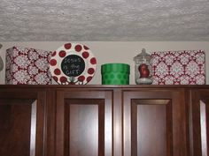Wrap empty boxes to set around the house to tie the whole house together. Add solid colored boxes too, and a glass far filled with ornaments.