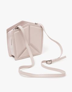 From IMAGO-A, a structured pentatonic leather bag in Desert Rose.  Features detachable adjustable shoulder strap, three panel Desert Rose design, wrap-around zipper, interior pressed logo, interior pocket, fully lined and structured base.  •Structured