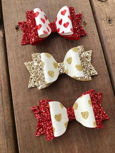 This listing is for one Valentines Day Hair bow. Your choice of red hearts with red glitter, gold hearts with red glitter, or gold hearts with gold glitter. Bow Measures approximately 4 long. The bow arrives attached to a Buns & Braids display card so its great for gifting. Bow can Holiday Hair Bows, Christmas Bows, Baby Bows, Bow Hair Clips, Diy Hair Bows, Diy Bow, Ribbon Hair Bows, Glitter Hair, Red Glitter