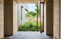 East House by Peter Rose - Modular Concrete Home on Martha's Vineyard in Chilmark, Massachusetts Concrete Facade, Concrete Houses, Conception Durable, Local Builders, Entry Hallway, Suites, House And Home Magazine, Prefab, Sustainable Design