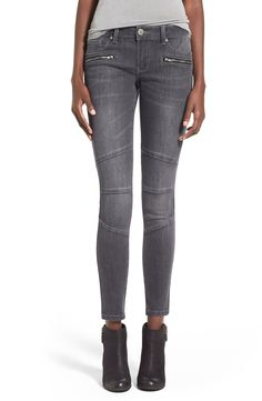 Horizontal zips and moto-inspired seams add city-girl edge to these soft and stretchy low-rise skinny jeans in a faded grey wash.