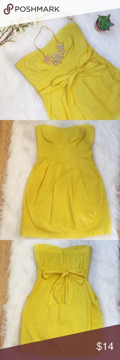 Trixxi Yellow Sweetheart Strapless Mini Dress Preowned Trixxi Strapless Yellow Pleat Dress Sash ties around waist Sweetheart neckline Side pockets Empire waist Slight padded cups Back zipper Gently used condition with no stains or fading. 2 puncture holes on each side of the front due to pins that are very inconspicuous though 2 tears on the inside seams but not noticeable from outside Size: Missing size tag. Probably junior small /3. Please see photos for measurements Missing fabric tag…