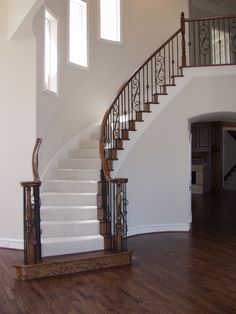 This staircase design was created using Twist series balusters. The double twist balusters (16.1.2), single basket twist balusters (16.1.3) and the spiraled scroll baluster (16.1.25) are paired to create a uniquely designed staircase. These components are available in Satin Black (shown), Silver Vein, Copper Vein, Oil Rubbed Bronze, Oil Rubbed Copper and Antique Nickel. We offer parts, install services, and custom components throughout Texas. Click the image for more information.
