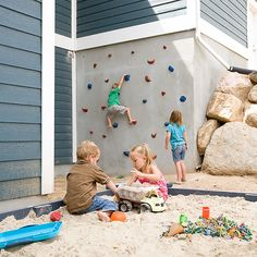 Keep the kids entertained and active throughout the warm-weather months by setting up a large-scale play area where they're welcome to get their hands dirty. A giant sandbox is a classic addition to any backyard play area, but try taking things one step further by turning an exterior concrete wall into a playful climbing wall.