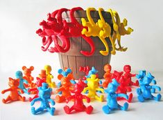 Barrel of Monkeys...I had these and loved them. The mickey's etc were cereal bowl huggers...loved them ! This simple toy requires fine motor dexterity, hand eye coordination, controlled force, and problem solving.