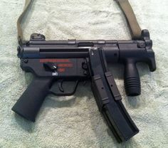 MP5 K Gun with Navy Lower. Factory HK device to attach 2 magazines shown. Factory down front grip to control rise.
