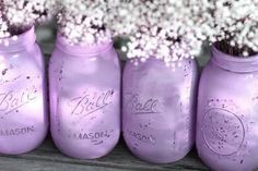 Marvelous mason jars distressed with lilac paint for a rustic or shabby chic style, great as wedding centrepieces! See more trends here: Lilac and Lavender Wedding Ideas
