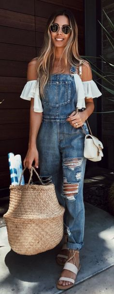 Trendy distressed denim overalls with cute off the shoulder white top.