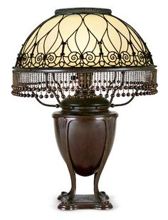 An early Tiffany Studios opalescent Favrile glass and reticulated bronze table lamp 1895-1918.